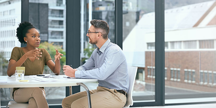 Two people in conversation during research interview