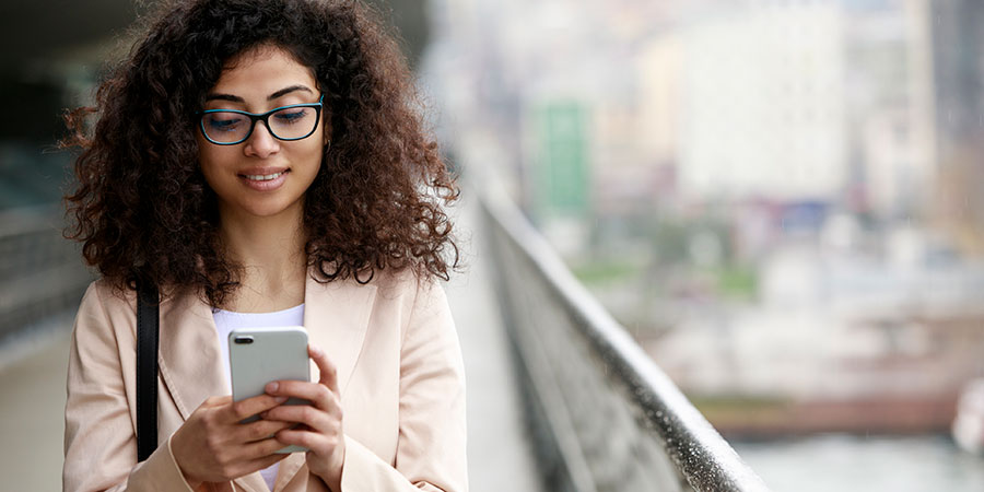 woman using smartphone to take survey